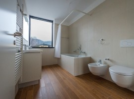 Grès porcellanato finto legno (pavimento) Grès porcellanato naturale (rivestimento) Stabile logistico amministrativo ex Cif | Rancate
